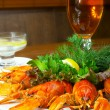 Crayfishs with beer on a table at restau — Stock Photo