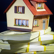 House on packs of banknotes - Stock Photo