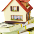 House on packs of banknotes — Stockfoto #1319482