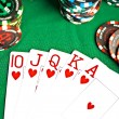 Man with a beard plays poker — Stock Photo #1319536