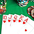 Man with a beard plays poker - Stock Photo