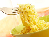 Hot and tasty noodles on a plug. — Stock Photo