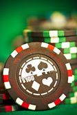 Gambling chips on green cloth — Stock Photo