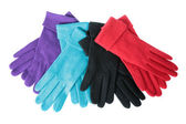 Multi-coloured woollen gloves on a white — Stock Photo