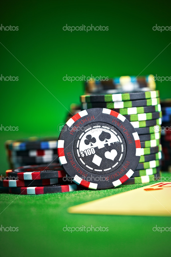 Gambling chips on green cloth...  Stock Photo #1319502