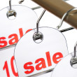 Sale. A hanger with labels on a white ba — Stock Photo #1320627