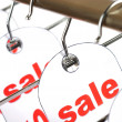 Sale. A hanger with labels on a white ba — Stock Photo