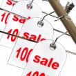 Sale. A hanger with labels on a white ba - Stockfoto