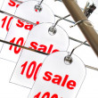 Sale. A hanger with labels on a white ba - Foto Stock