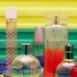 Stock Photo: Glass bottles with perfumery. On a color