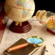 The globe, magnifier with a notebook and — Stock Photo