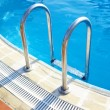 Ladder in pool — Stock Photo