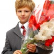 The boy with a bouquet of colors - Stock Photo