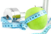 Dumbbells and apple. A healthy way of li — Stock Photo