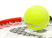 Tennis racket with a ball. — Stock Photo