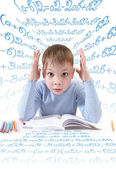 The schoolboy with the book — Stock Photo