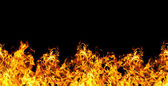 Seamless fire on a black background — Stock Photo