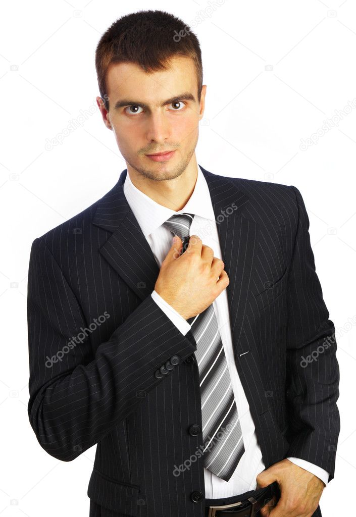 Young man in a suit on a white background... — Stock Photo #1323209