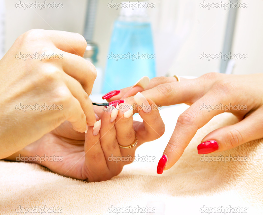 Manicure process... Female hands...  Stock Photo #1324303