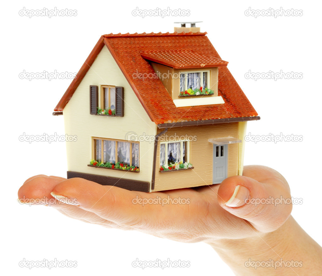 The house in human hands... — Stock Photo #1324383