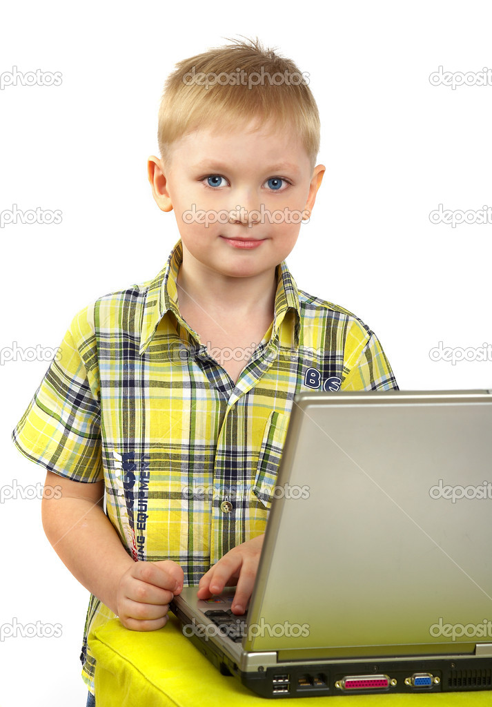 The boy the blonde is engaged with a computer... — Stock Photo #1329067