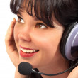 Girl in headphones with a microphone — Stock Photo