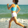 Stock Photo: Girl runs along sea...