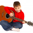 Boy with an acoustic guitar — Stock Photo