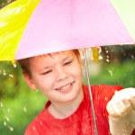 Boy under an umbrella during a rain — Stock Photo #1331407
