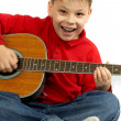 Boy and acoustic guitar - Stock Photo
