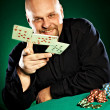 Man with a beard plays poker — Stock Photo