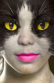 Catwoman with brightly yellow eyes — Stock Photo