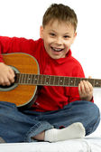 Boy and acoustic guitar — Stock Photo