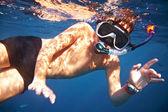 Boy floats under water — Stock Photo