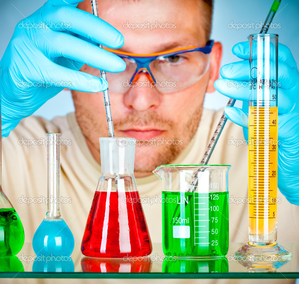 Scientist in laboratory with test tubes  Stock Photo #1526569