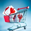 Shopping cart ahd gift — Stock Photo