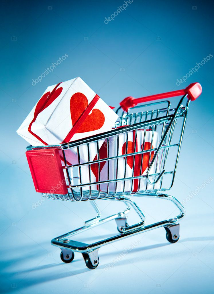 Empty shopping cart on the blue — Stock Photo #1623097