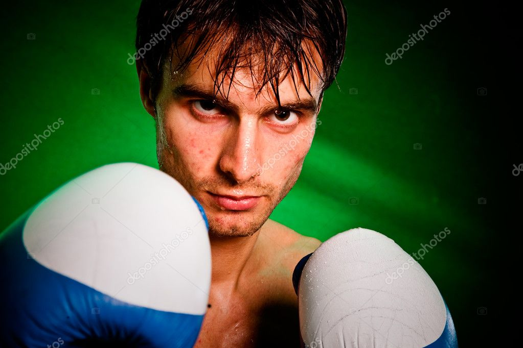 Man sweating all over in boxing gloves... — Stock Photo #1623256