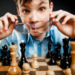 Stock Photo: Nerd play chess
