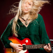 Girl with a guitar - Stock Photo