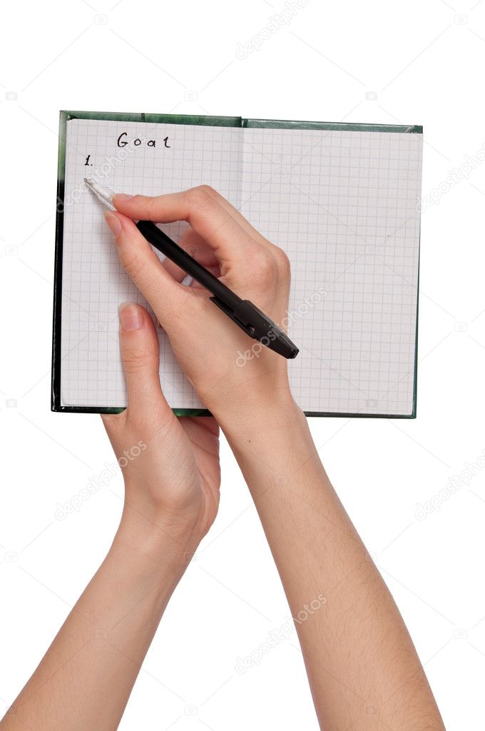 Business woman writes goal for  business plan  Stock Photo #2688231
