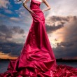 Beautiful girl in a long red dress — Stock fotografie