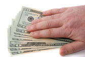 Male hand over dollars — Stock Photo