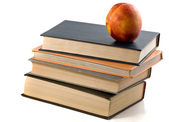 Books and nectarine — Stock Photo