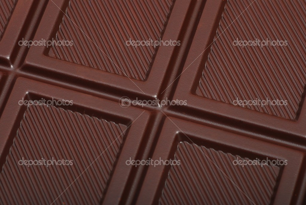 Dark chocolate bar pieces background — Stock Photo #1113414