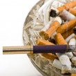 Stock Photo: Ashtray full of cigarettes
