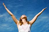 Girl over blue sky — Stock Photo