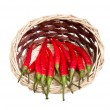 Wooden basket full of red peppers. — Stock fotografie