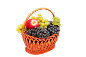 Bunches of grapes and apples in basket. — Stock Photo