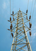 Blue sky and iron electrical tower. — Stock Photo